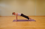 Step the left foot back to Plank